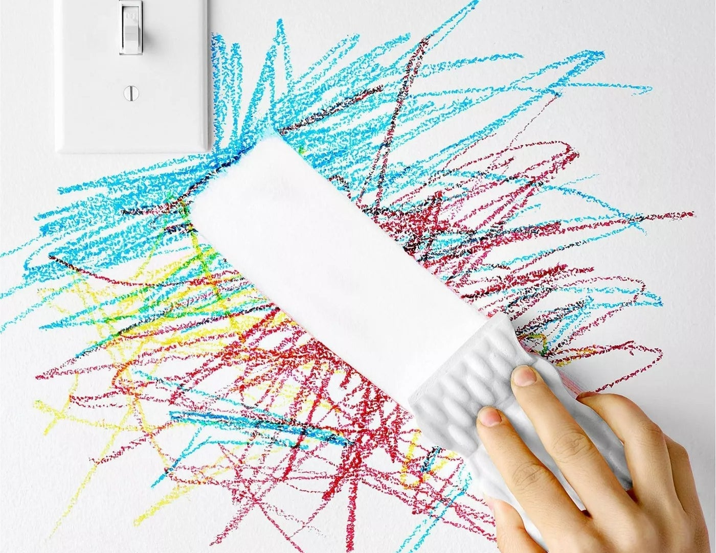 A Magic Eraser removing crayon from a wall