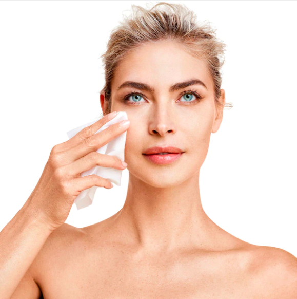 A person uses the exfoliating cloth to wipe their face