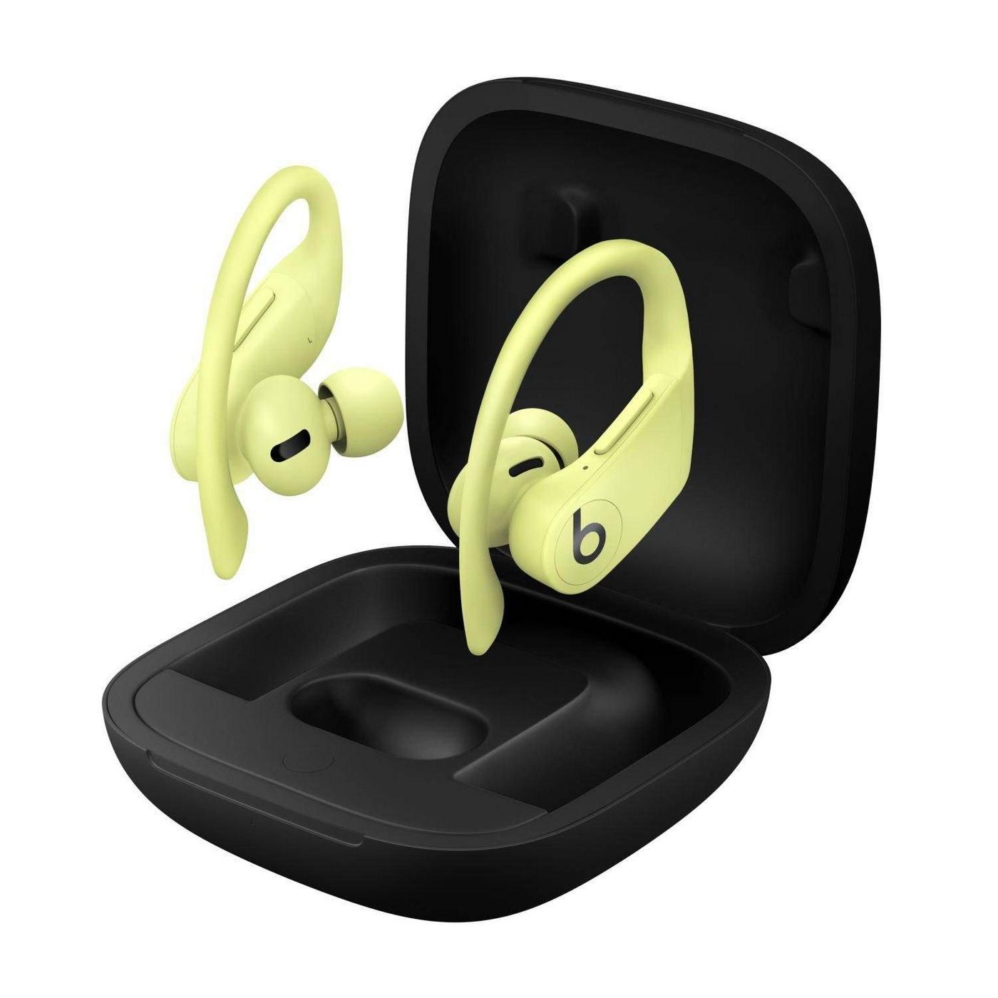 yellow powerbeats pro true wireless headphones going into a black case