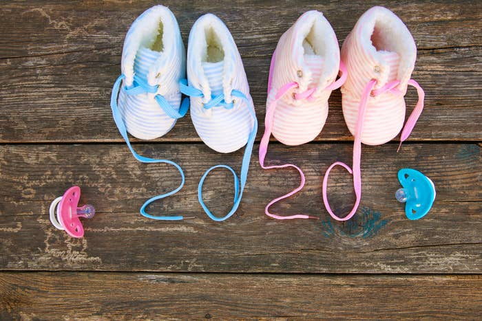 Baby booties with show laces that spell out 2020