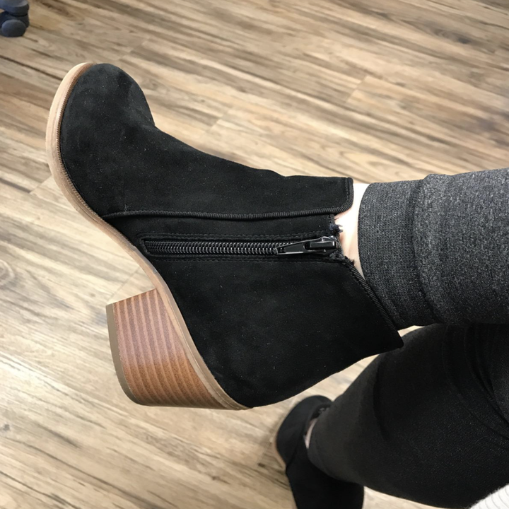 reviewer wearing the black booties