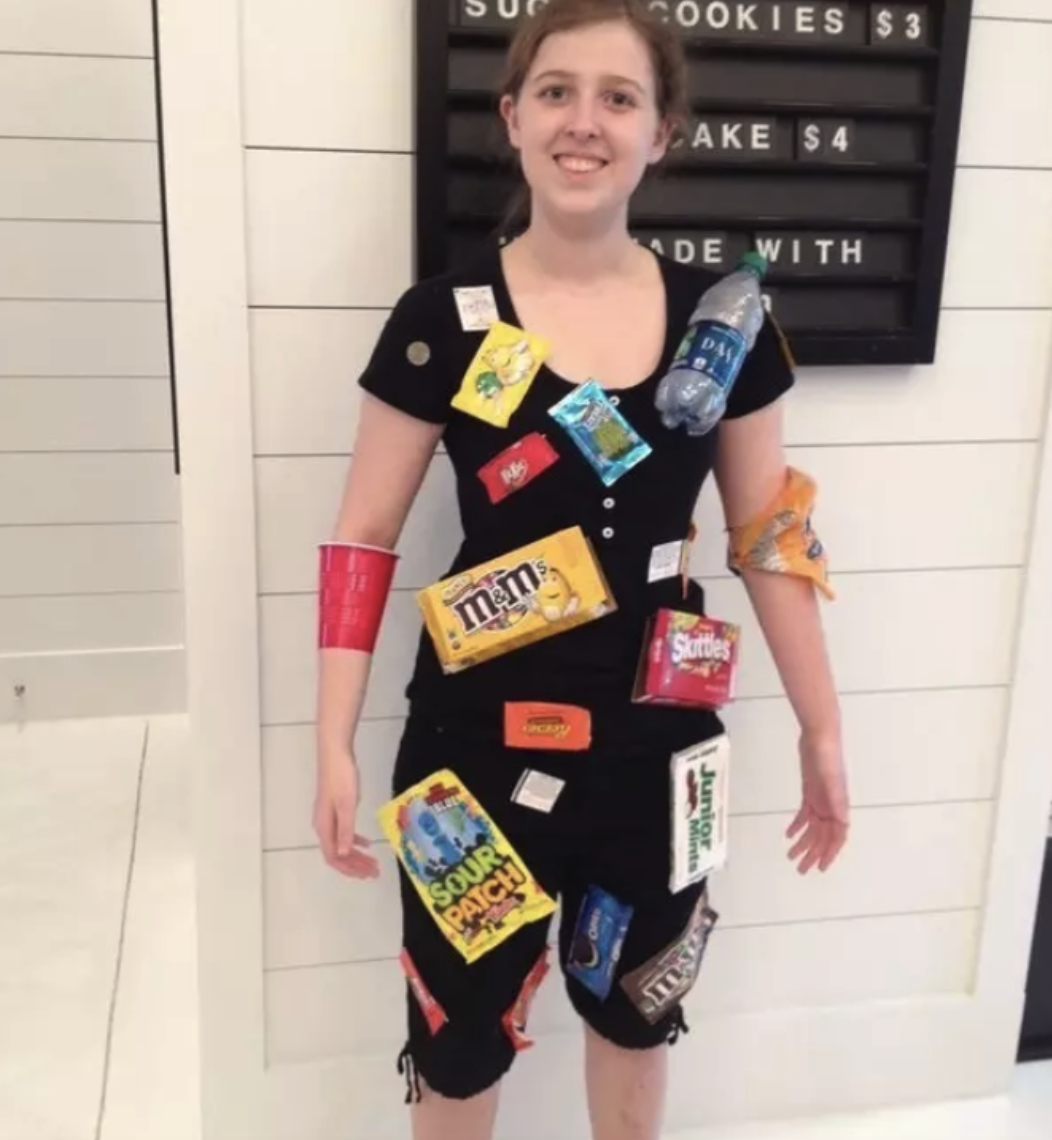 Someone dressed in all black who taped concession stand candy to their body