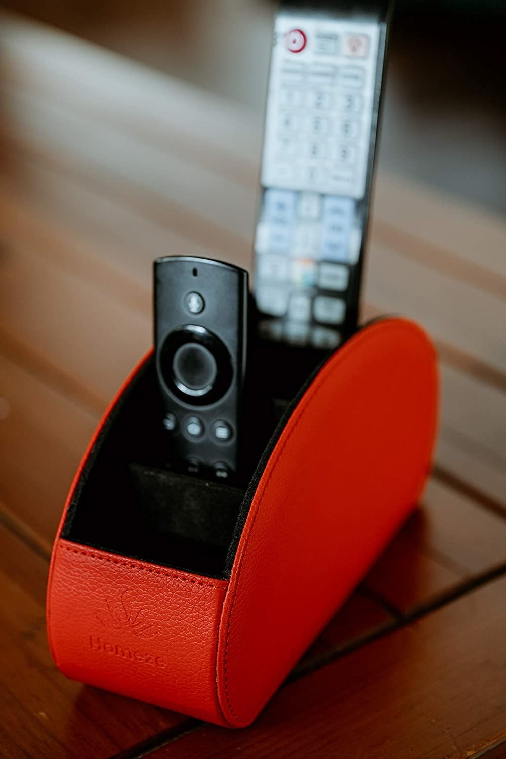 The remote caddy open on a side table, showing the two remote controls inside