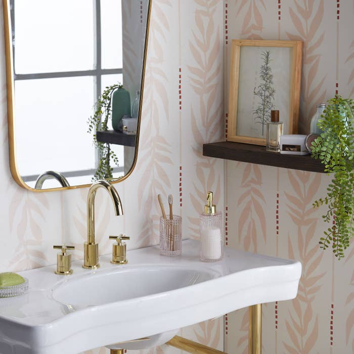 The wallpaper featured in a stylish bathroom