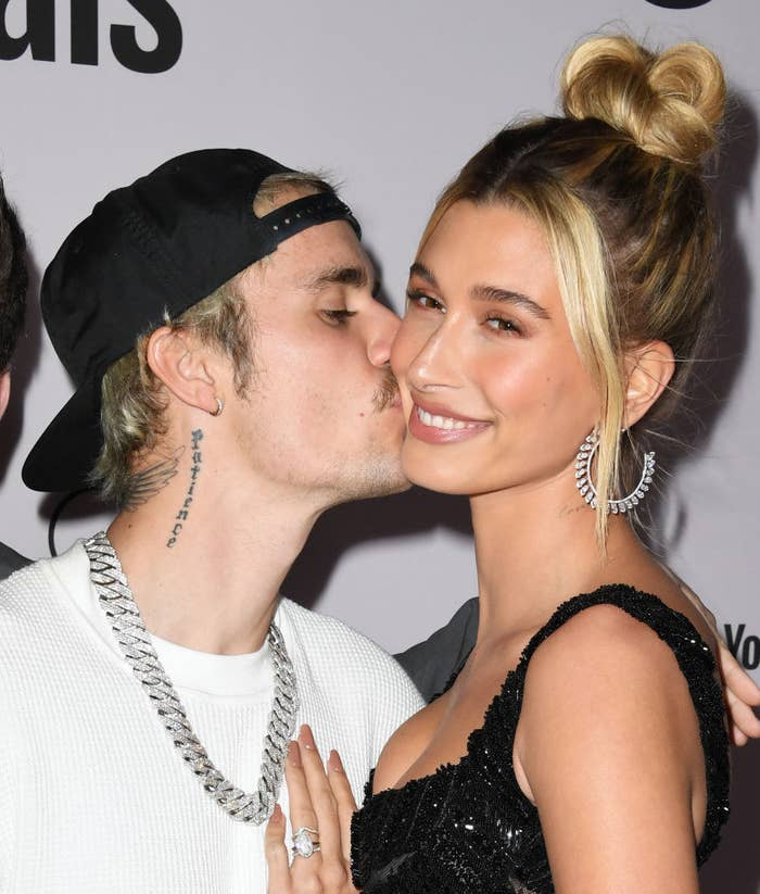 Justin kissing Hailey's cheek