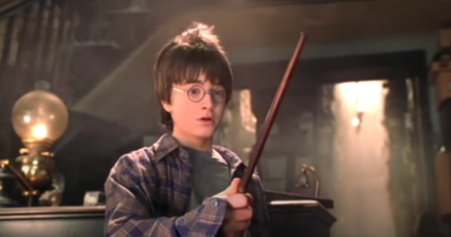 Harry Potter tries out his magic wand for the first time in Ollivander's