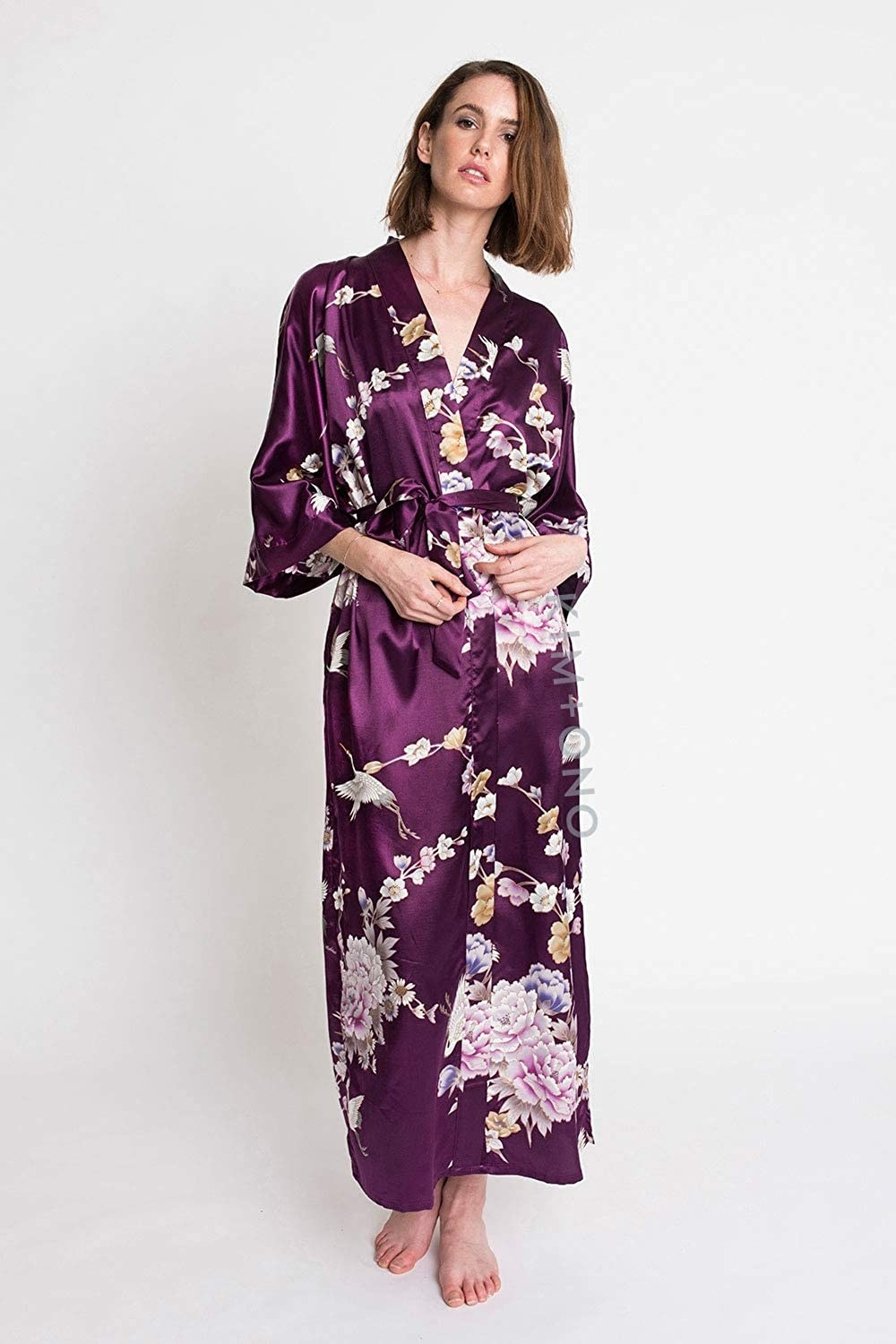 A model wears the KIM+ONO satin kimono robe in the plum Chrysanthemum & Crane design