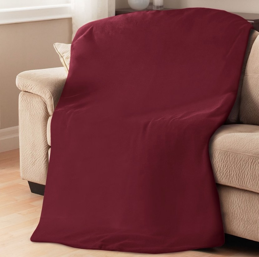 Red throw blanket over tan colored couch
