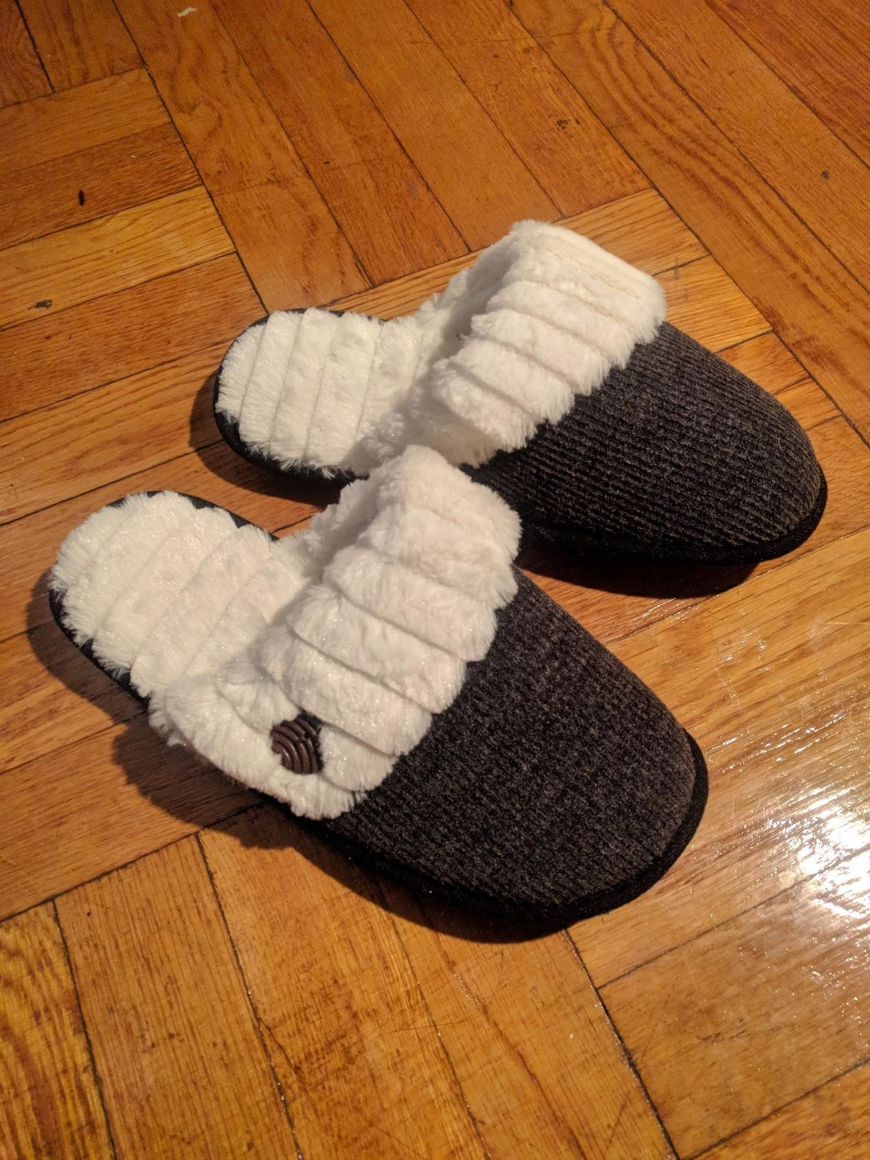 A customer's pair of HomeTop fuzzy knitted slippers