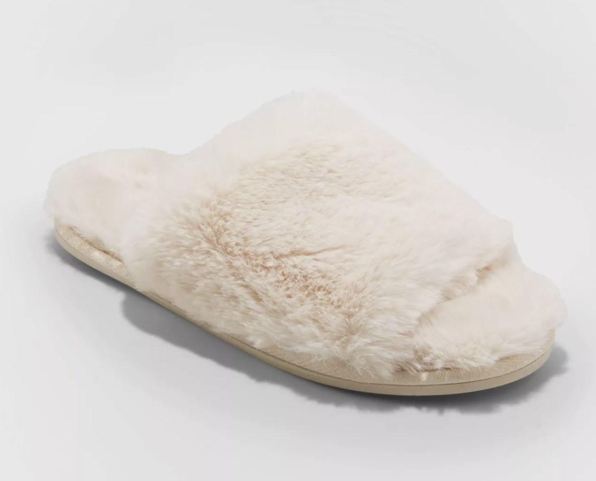 an ivory fuzzy slip-on slipper