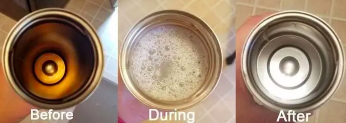 Reviewer shows Bottle Bright Tablet cleaning up bottom of silver container after it was stained by beverages
