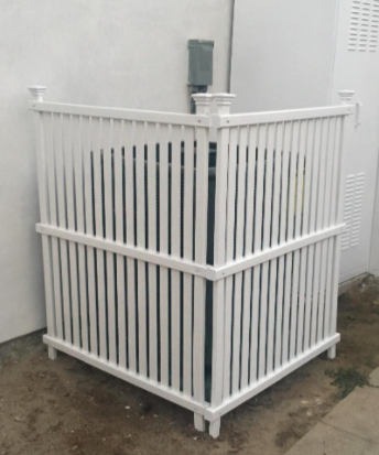 the fencing blocking a trash can