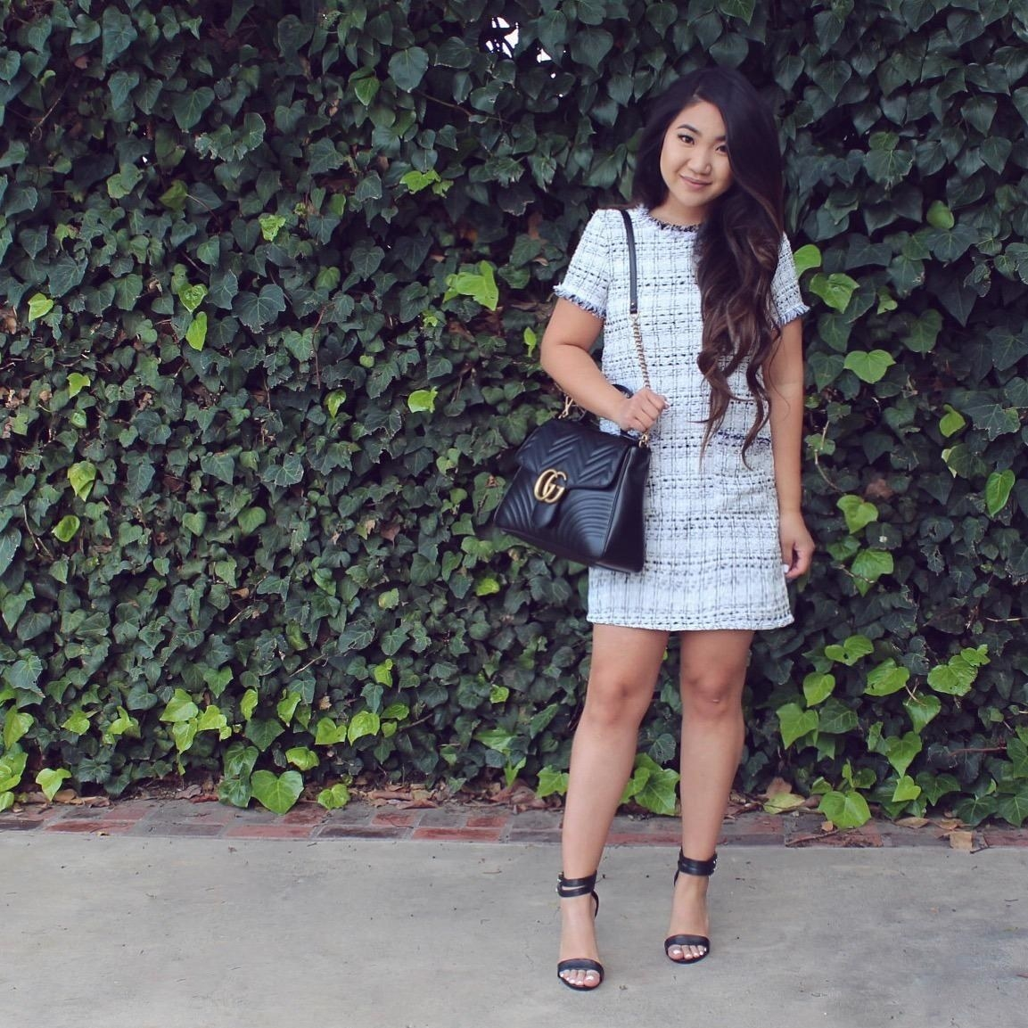A reviewer wearing the gray and white tweed short sleeve mini dress