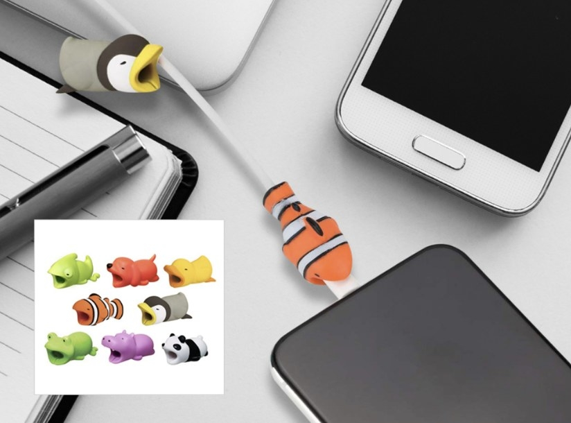 Rubber goldfish protector on charging cable attached to phone with picture of eight other animal cable protectors
