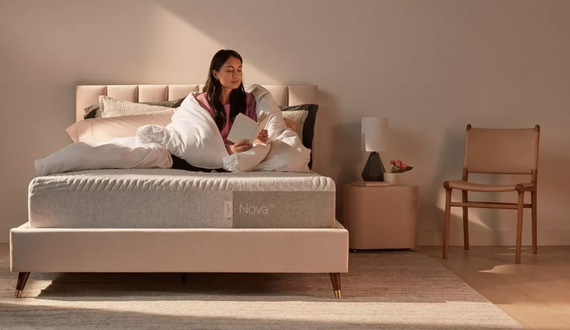 a model reading on a mattress