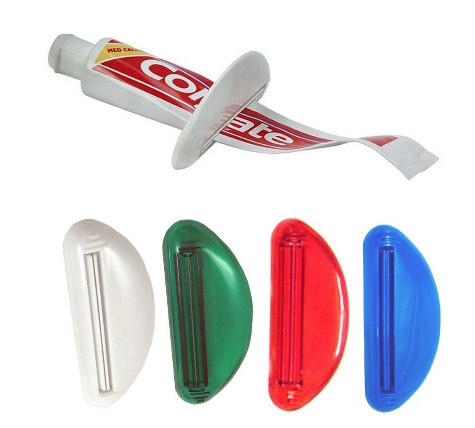 White toothpaste squeezer on Colgate toothpaste and four squeezers at the bottom in white, green, red and blue