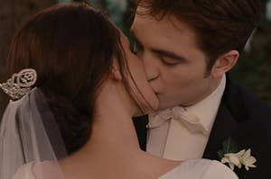 Edward and Bella from Twilight kissing on their wedding day