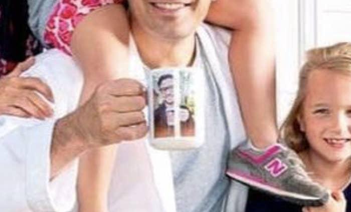 A closeup of Jimmy Fallon holding a mug of Justin Timberlake's face.