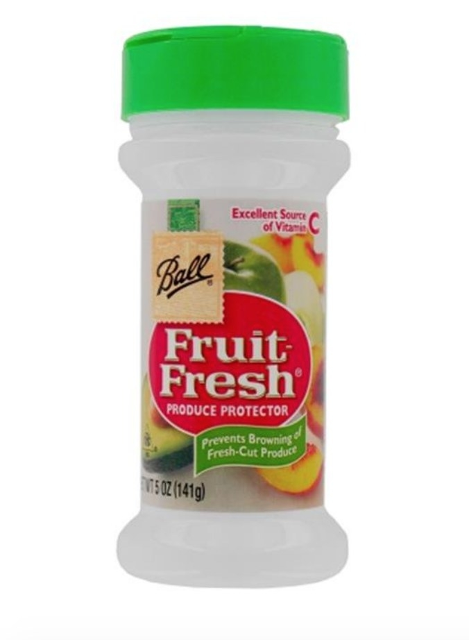Bottle of Fruit Fresh produce protector powder with green cap and red Fruit Fresh logo