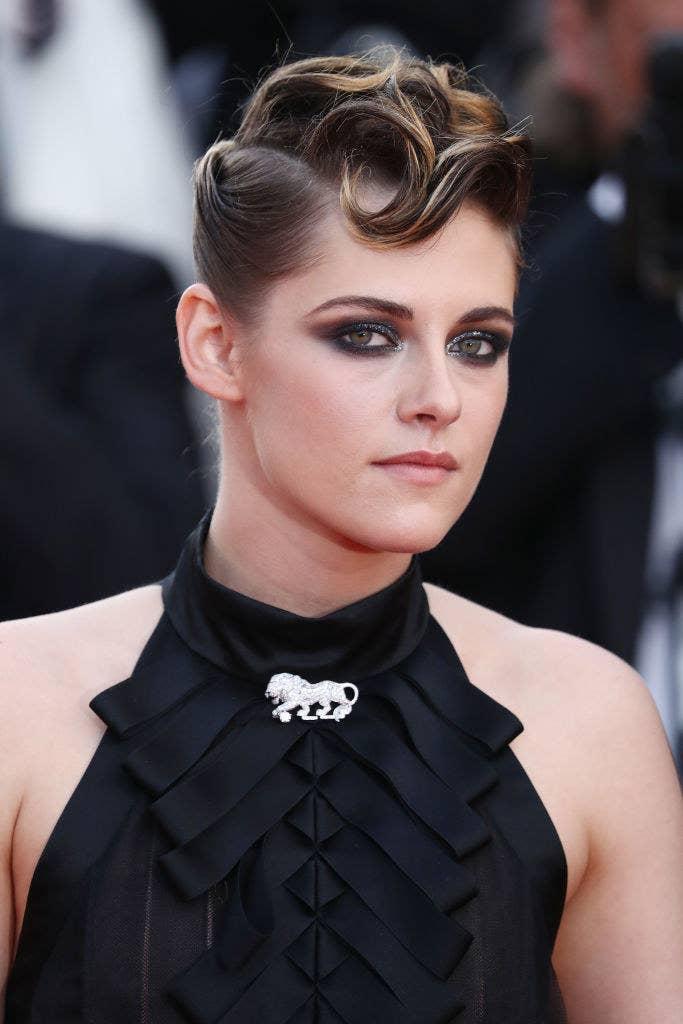 Kristen in a dark dress with her hair up