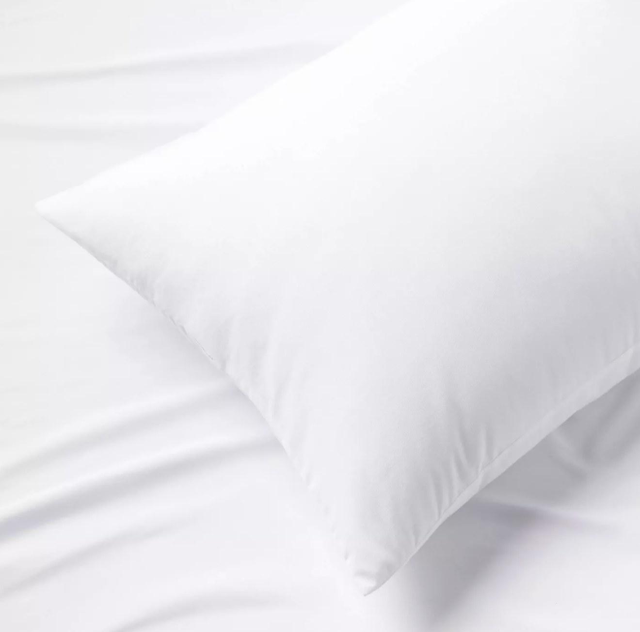 a white memory foam pillow on a white sheet