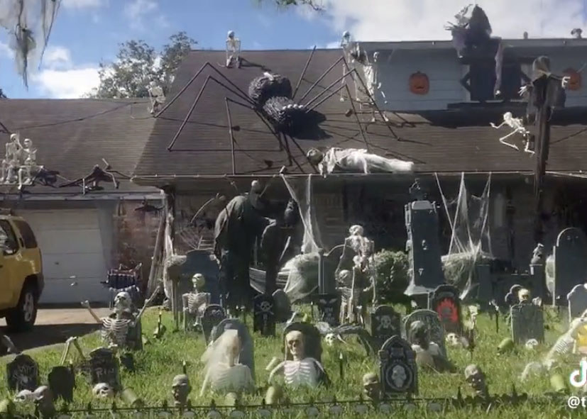 A fake graveyard with skeletons popping out of the ground