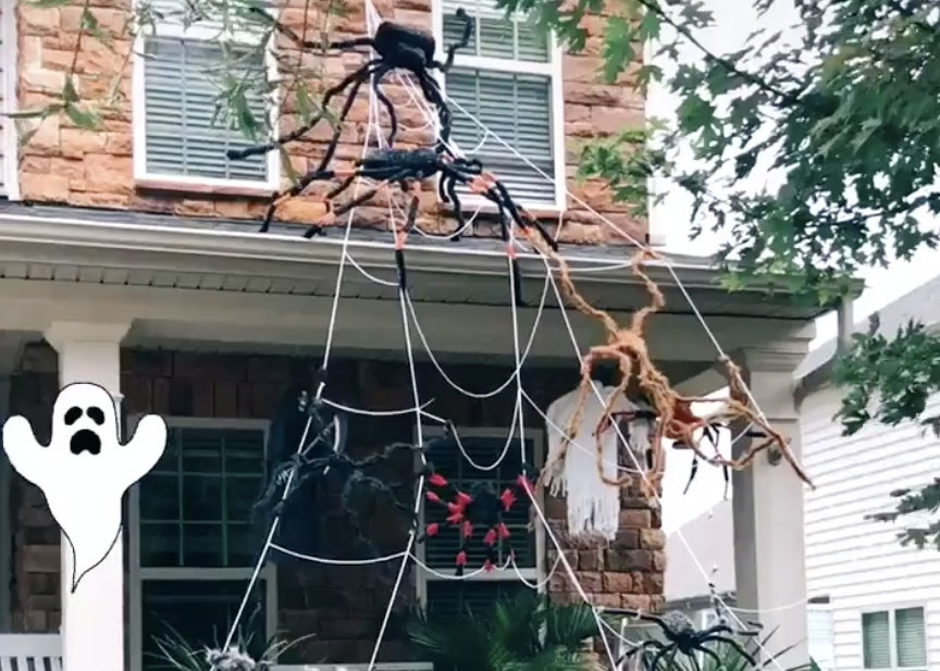 A home with a large spiderweb spanning two stories