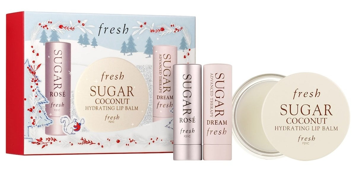 Sugar Lip Balm Rose and Dream Tins and the Sugar Hydrating Balm pan with holiday-themed packaging. These products are formulated without sulfates (SLS and SLES), parabens, phthalates, and more