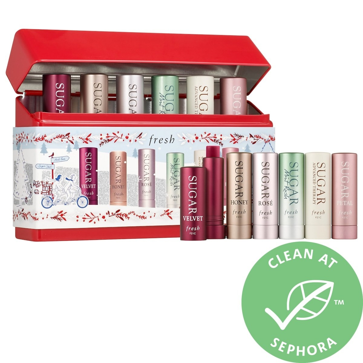 Six lip balm tins inside holiday-themed packaging. These products are formulated without sulfates (SLS and SLES), parabens, phthalates, and more