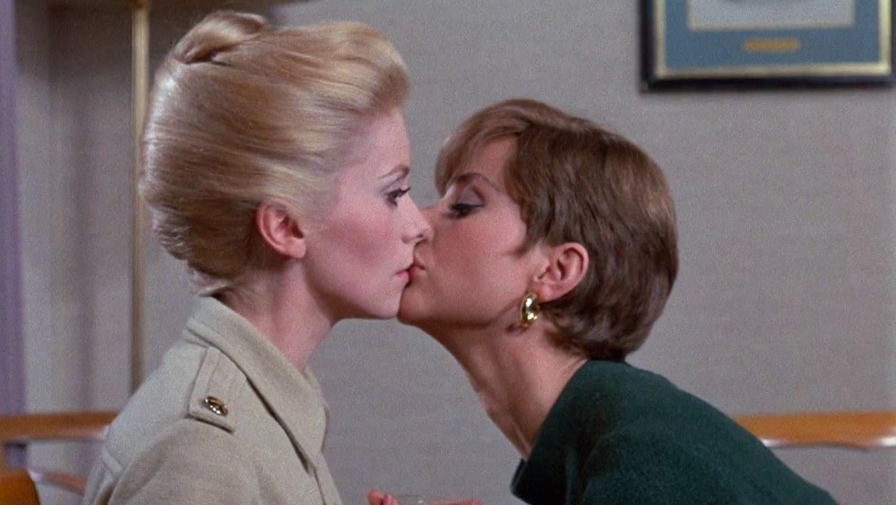 Catherine Deneuve (Belle de Jour) kissing Geneviève Page (Madame Anaïs) in 'Belle de Jour'