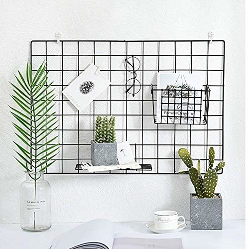 The grid organiser pictured with documents, plants and a pair of glasses on it.