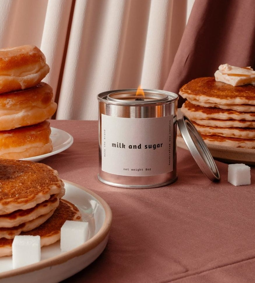 The candle surrounded by stacks of pancakes and sugar cubes