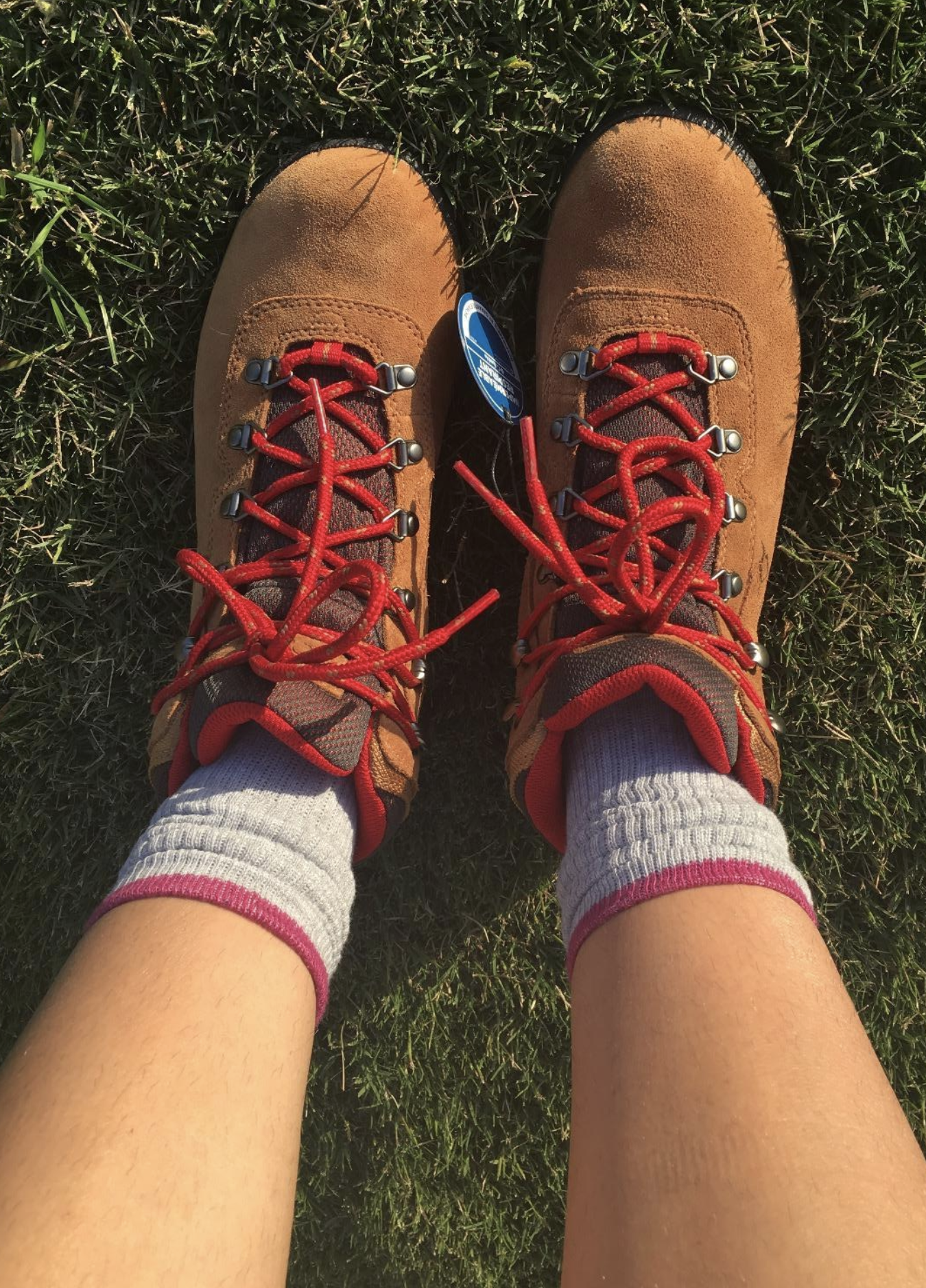 reviewer wearing the brown boots with red laces