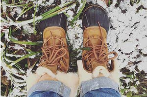 model wearing the brown and black snow boots