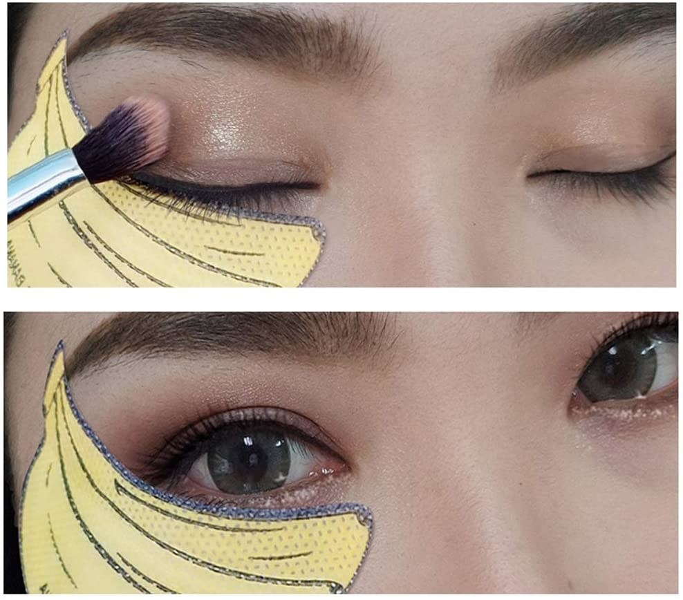 A person with a small sticky pad underneath their eye while they apply makeup