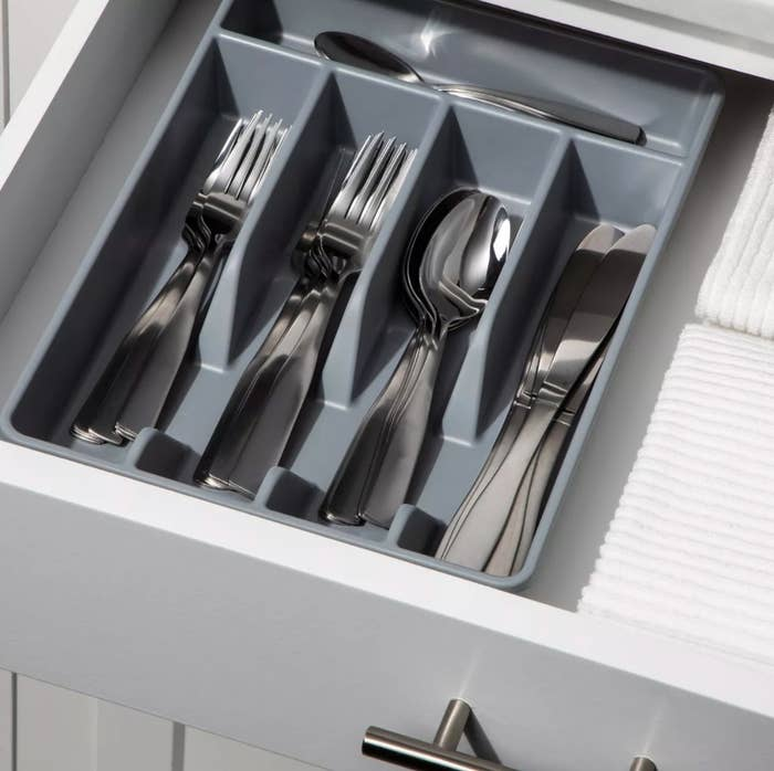 The drawer organizer in gray holding silverware