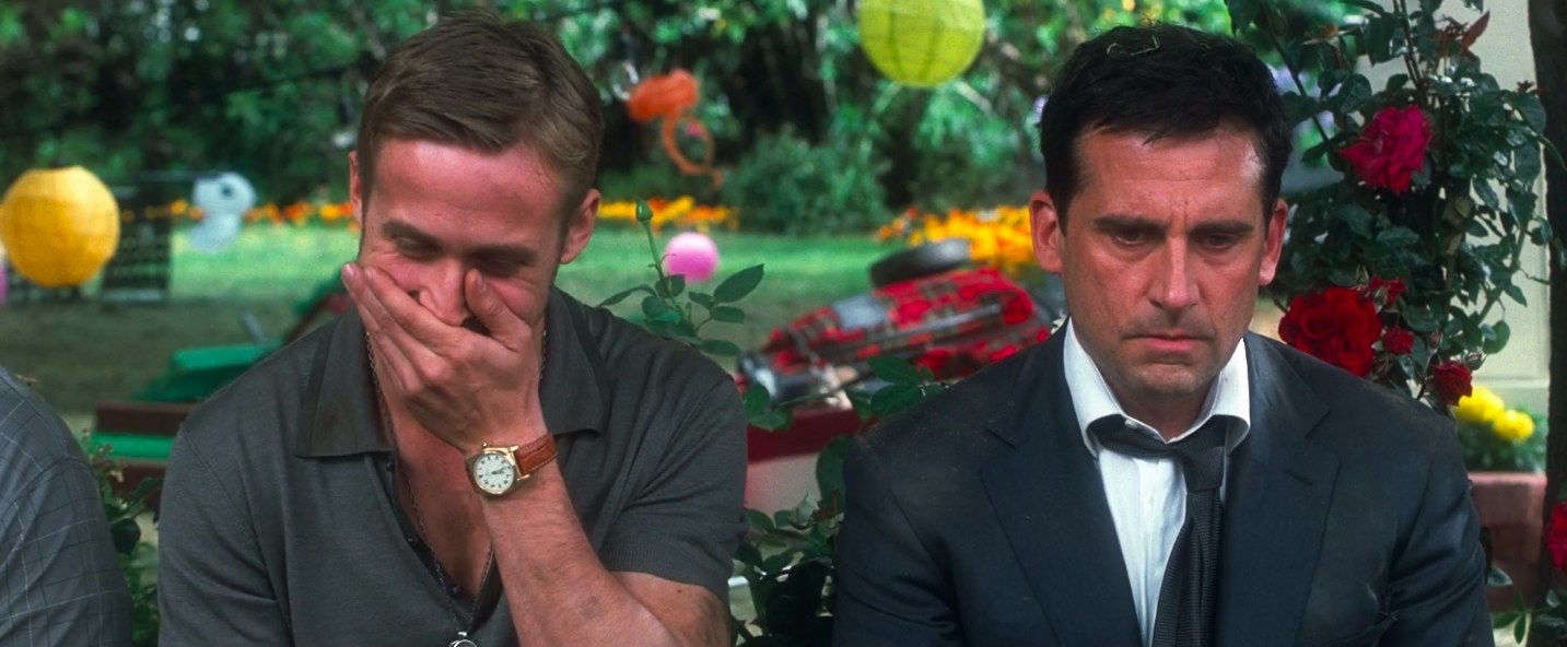 """ryan gosling laughing with hand over this mouth with steve carrell looking serious in """"Crazy Stupid Love"""""""