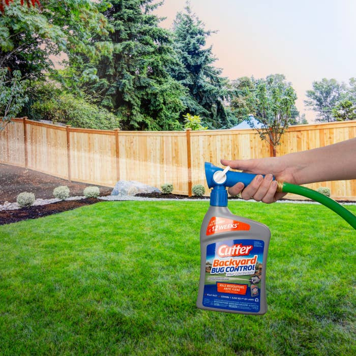 Model attaching hose to spray bottle and spraying it in yard