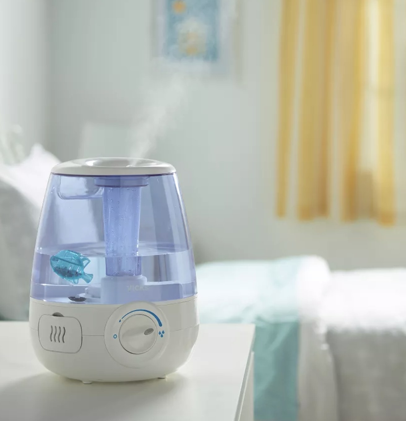 a blue and white humidifier in a bedroom