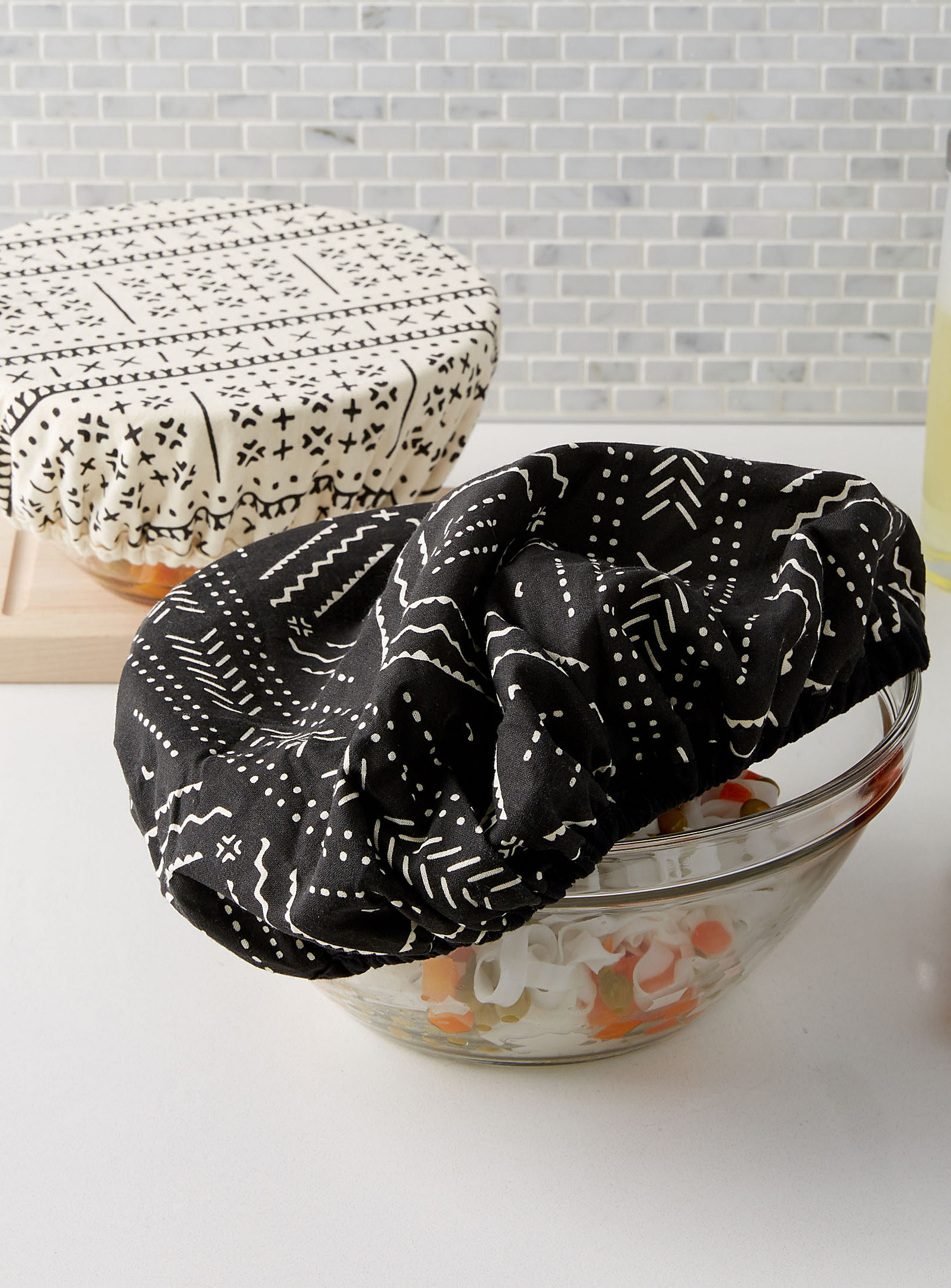 Two bowl covers over a bowl