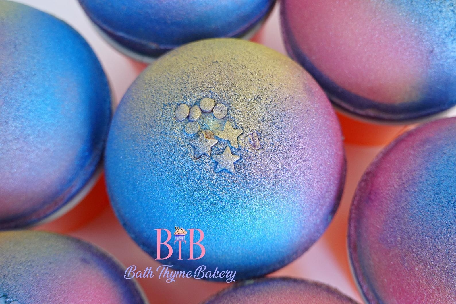 A shimmery blue purple and yellow bath bomb