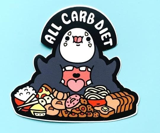 "A cutesy version of No Face from ""Spirited Away"" with his mouth open and surrounded by food like pizza, bread, donuts, and rice with the text ""All carb diet"""
