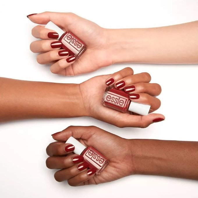 Essie red nail polish on three different skin tones