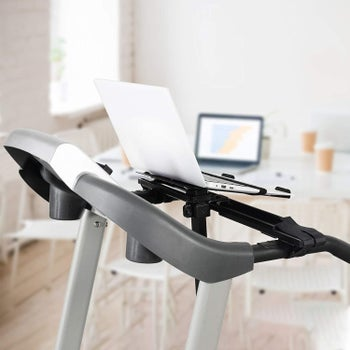 A laptop secured on an attachment on a treadmill