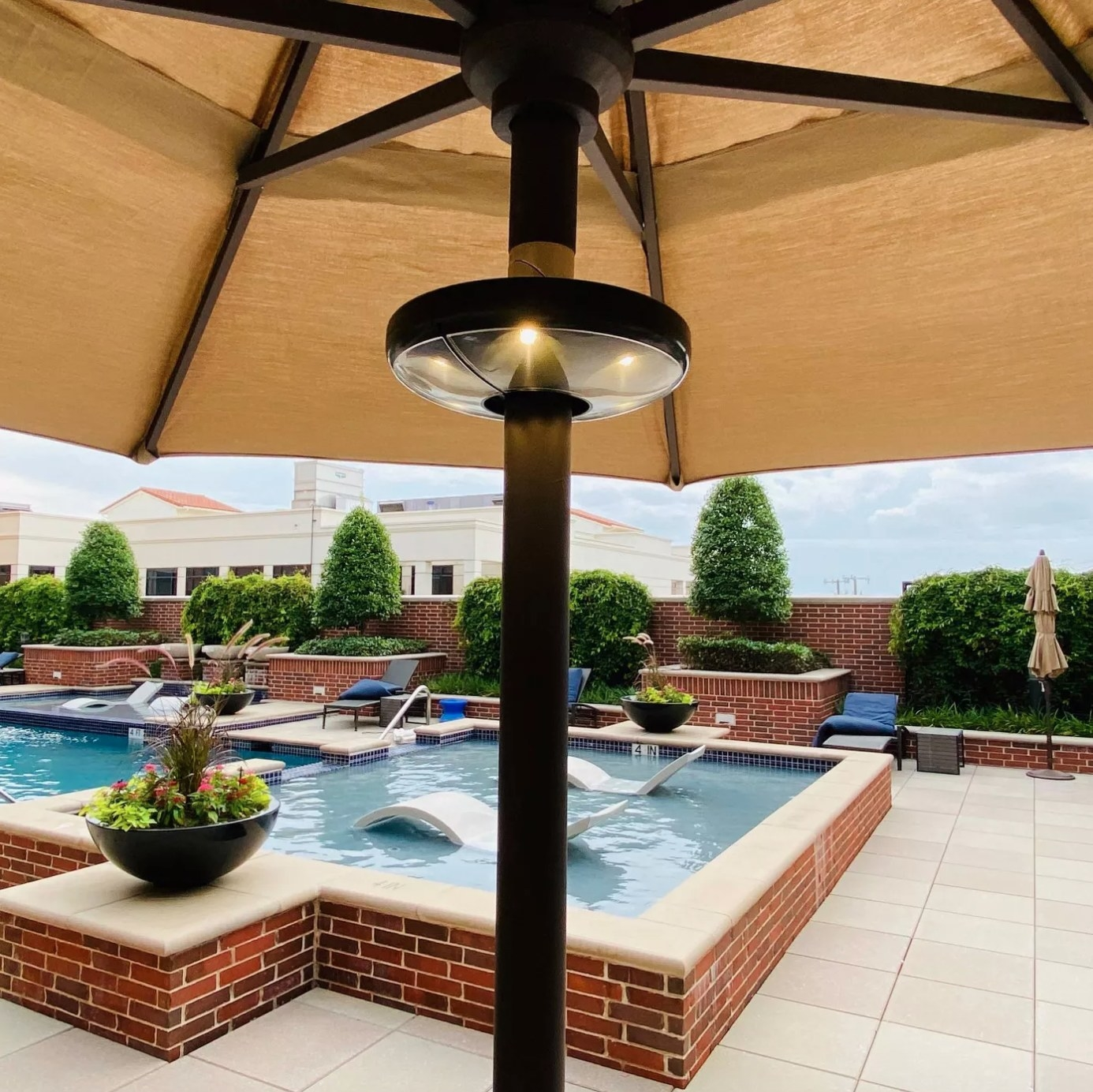 The LED patio umbrella light in black and clear