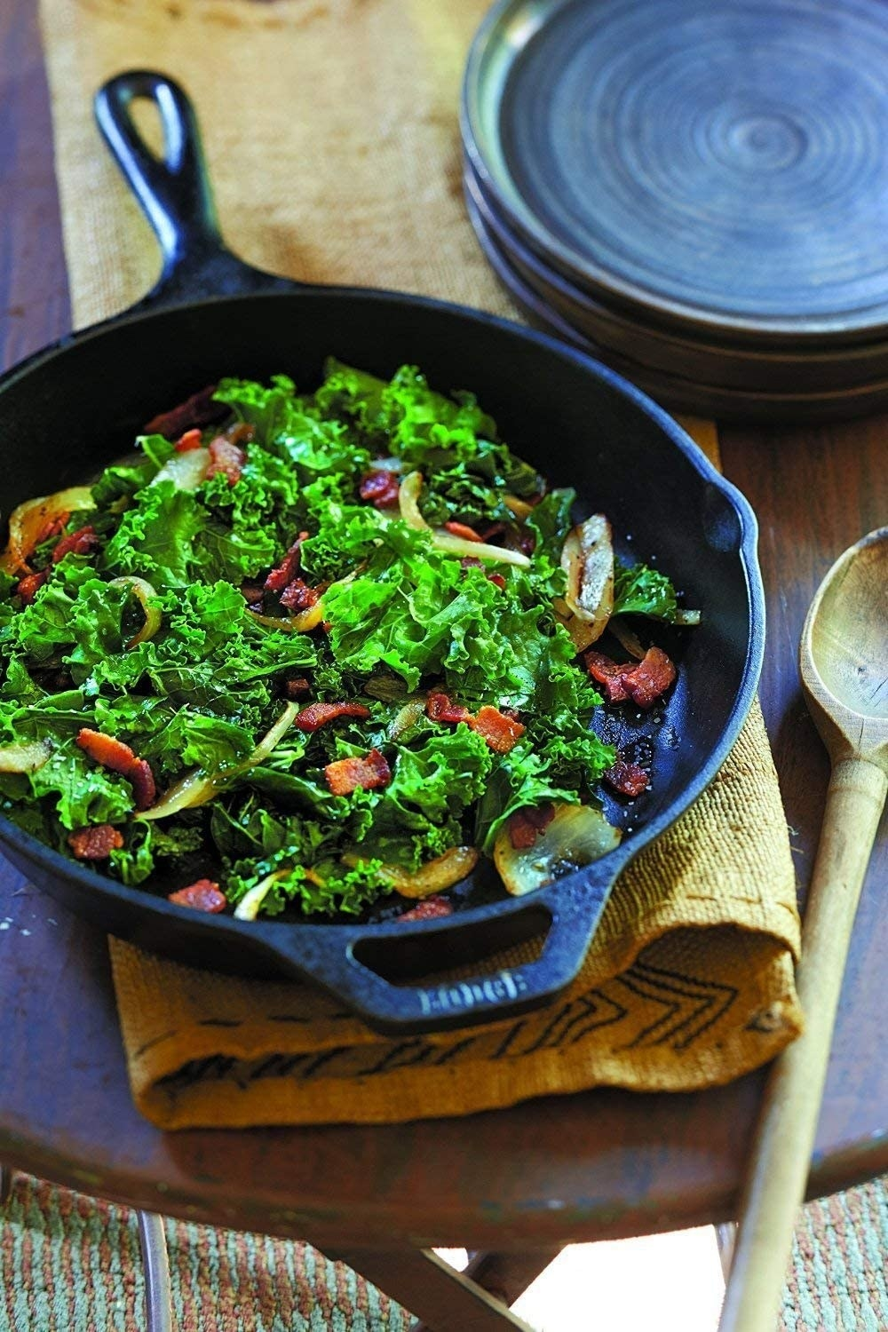 Cast iron skillet filled with greens