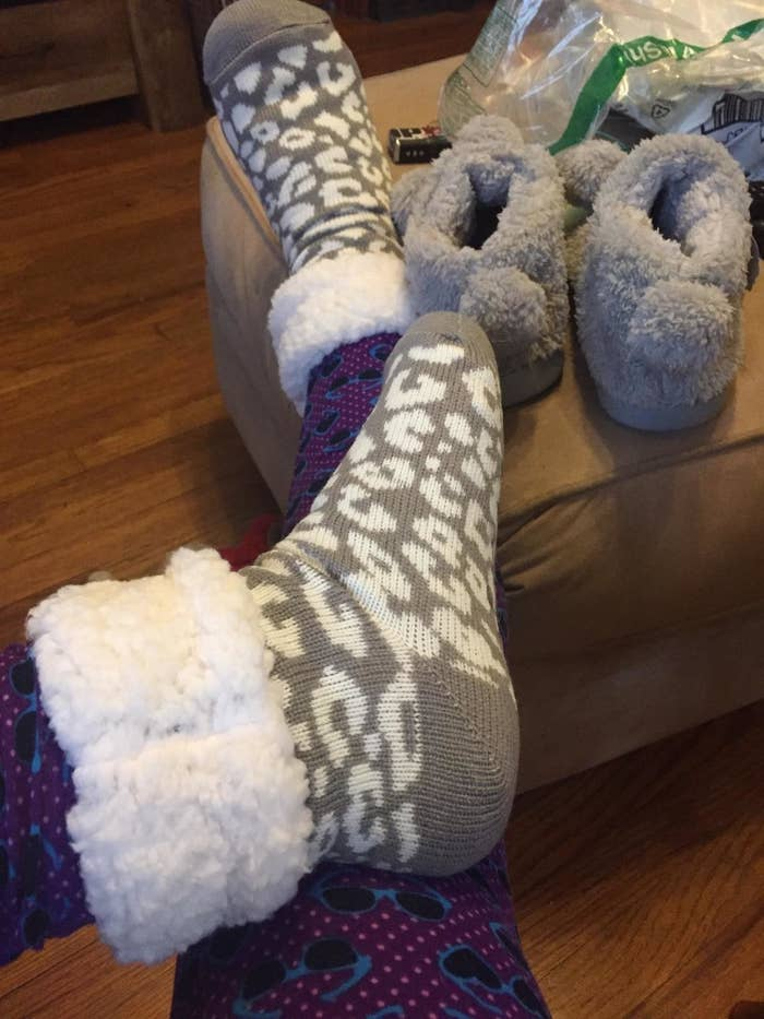 Reviewer in the grey leopard print socks with sherpa cuff