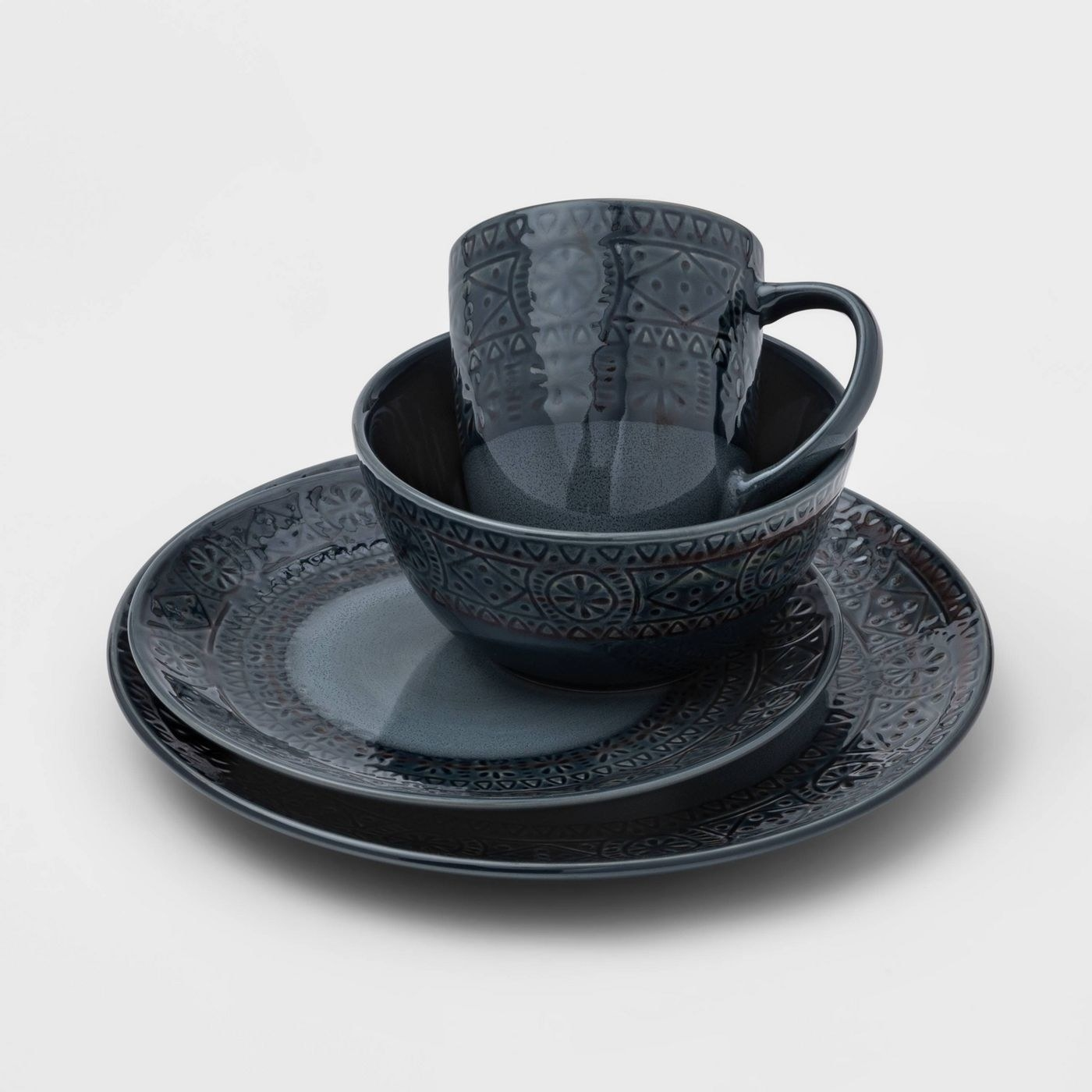 Four pieces of the ceramic kingfield debosseed dinnerware set from threshold