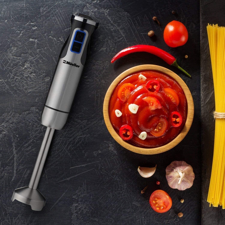 Handheld blender beside tomato paste