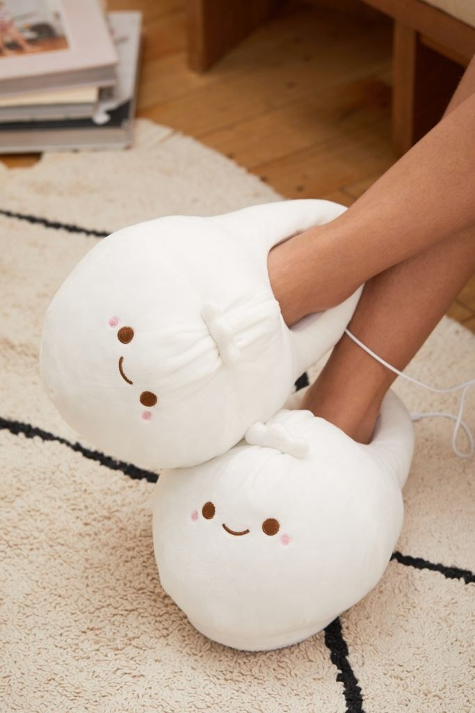 Close up of the smoko heated slippers on a model's feet